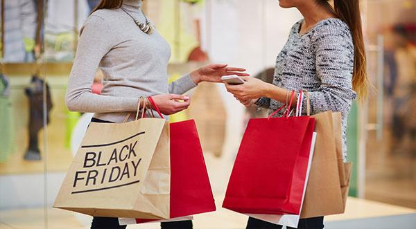 Girls doing shopping on Black Friday sales 2021